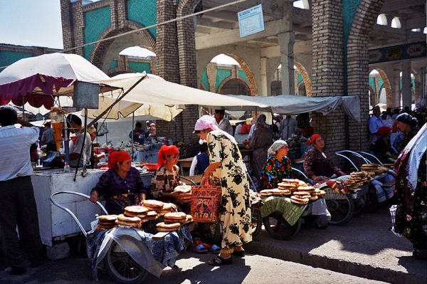 Bread sellers with their traditional flat round loaves of Uzbek bread. Photo by upyernoz.
