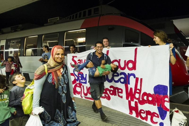 Vienna, Austria. 1 September 2015 -- A banner is held up by a group welcoming refugees arriving from Syria and Afghanistan at Vienna Railway Station where they plan to stay overnight en route to Germany. Photo by Martin Juen. Copyright Demotix