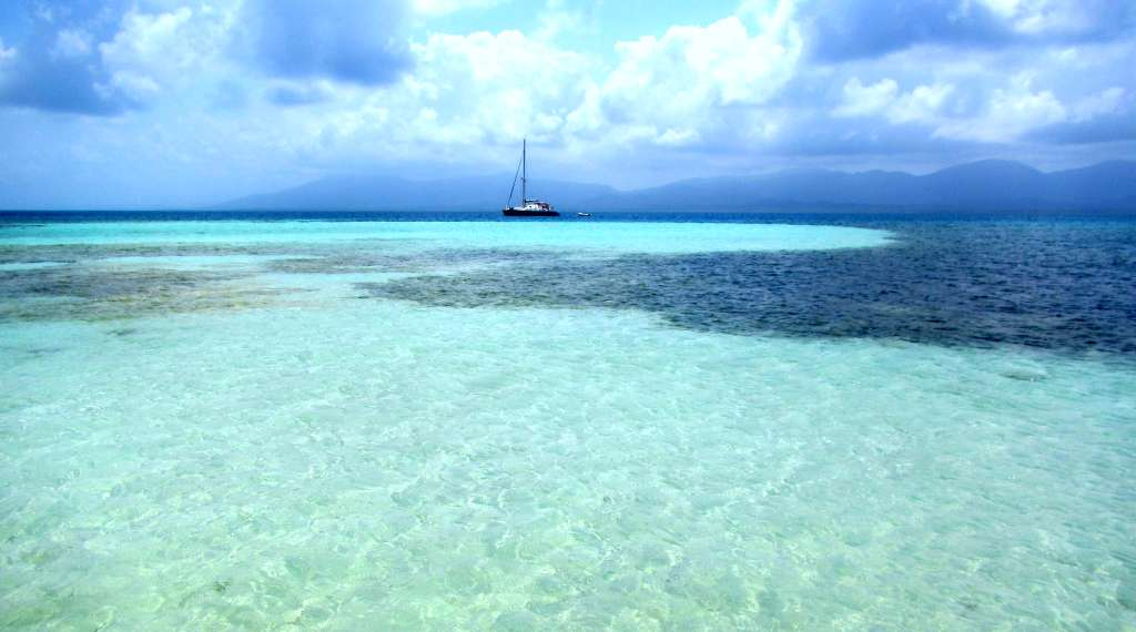 Our catamaran moored in the Tiffany-blue waters of San Blas, Panama