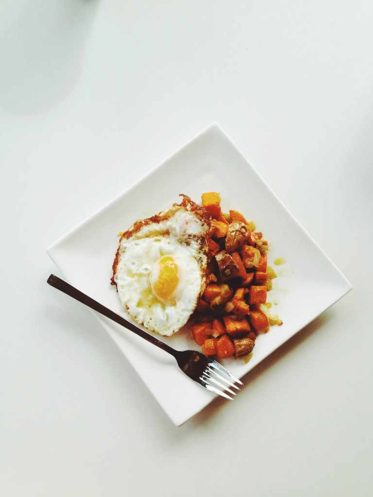 fried eggs and sweet potato hash
