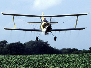 Farmer applies insecticide targeted against western corn rootworms in soybeans. Photo by Ken Hammon.