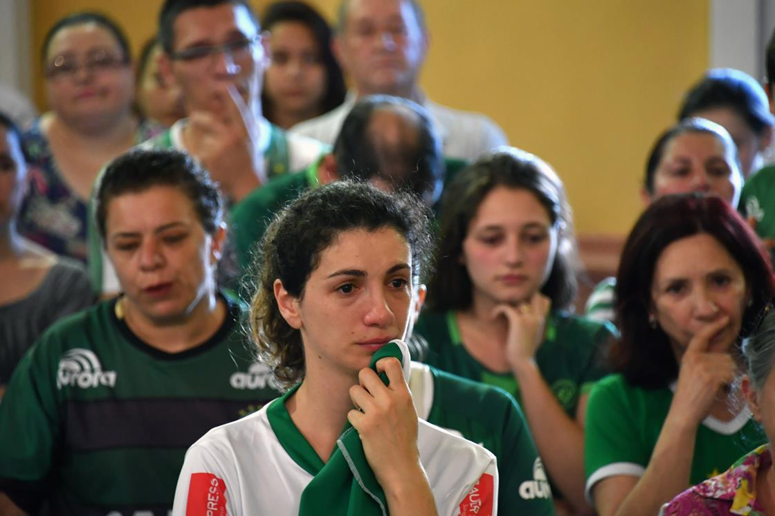 """""""To lose (almost) all of them in such a tragic way, totally destroyed our city and each one of us,"""" Carla Vilembrini said late Tuesday, standing outside Santo Antonio Cathedral. She was dressed like so many others — in the club's green and white jerseys. Source: Taiwan News"""