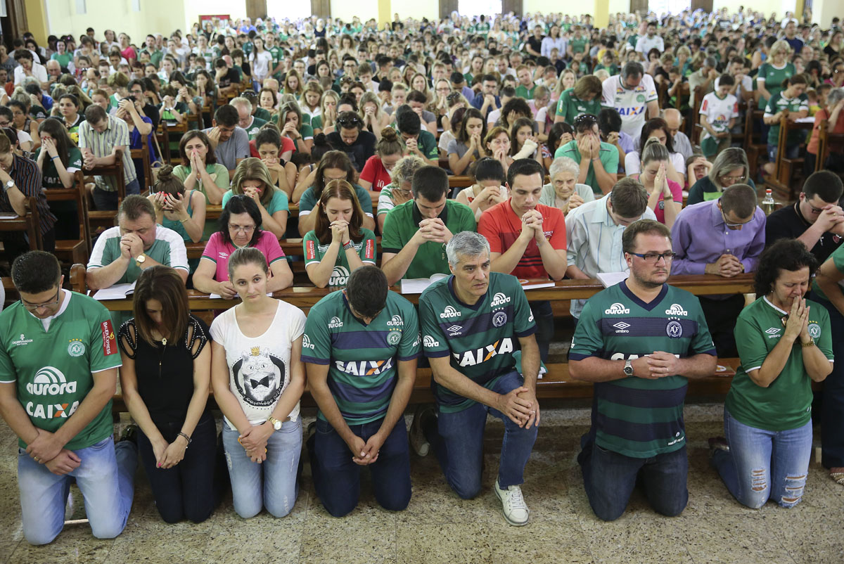 Supporters of Brazil's football team Chapecoense attend Mass at the city's Cathedral in Chapeco, Brazil, Tuesday, Nov. 29, 2016. A chartered plane carrying the Brazilian football team Chapecoense to the biggest match of its history crashed into a Colombian hillside and broke into pieces, killing most passengers, Colombian officials said Tuesday. (AP Photo/Andre Penner)