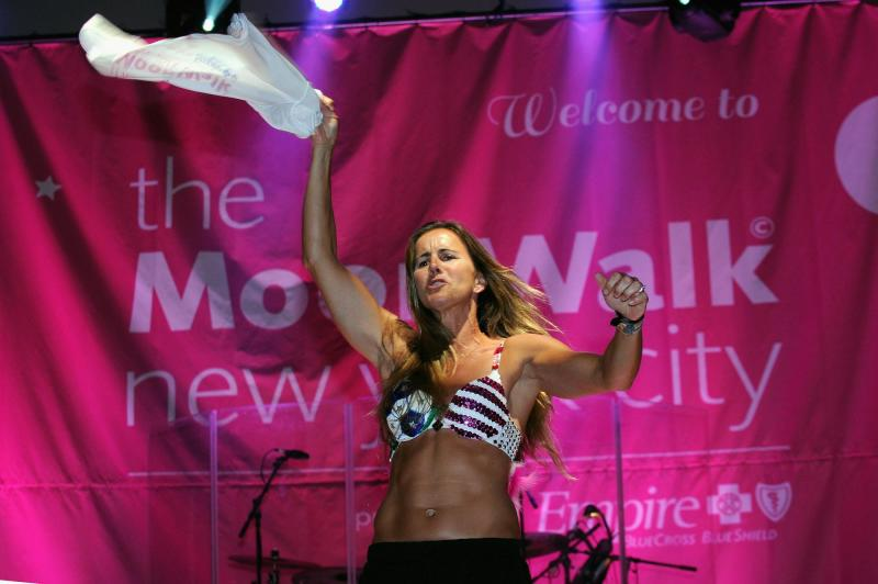 Brandi Chaistain re-enacts her sports bra celebration at a Manhattan charity even