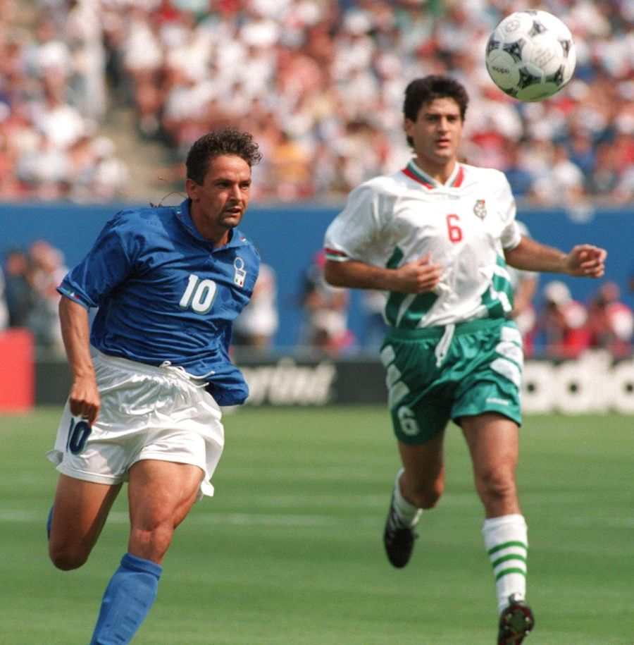 Italian forward Roberto Baggio (L) outruns Bulgarian defender Zlatko Iankov as he chases the ball during the World Cup semifinal soccer match between Italy and Bulgaria 13 July 1994 in East Rutherford. Baggio scored two goals to help Italy qualify for the final with a 2-1 victory. AFP PHOTO/TIM CLARY