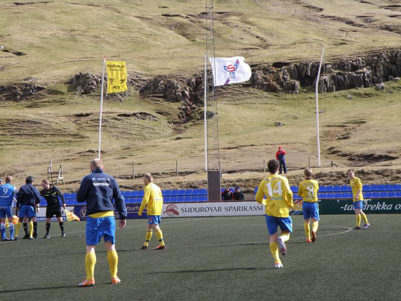 FC Suðuroy 5 vs B71 Sandoy in the Quarter Final in the Faroe Islands Cup 2012 - One of the Flag Poles couldn't stand up against the strong wind [Photography - Eileen Sanda / Flicker]
