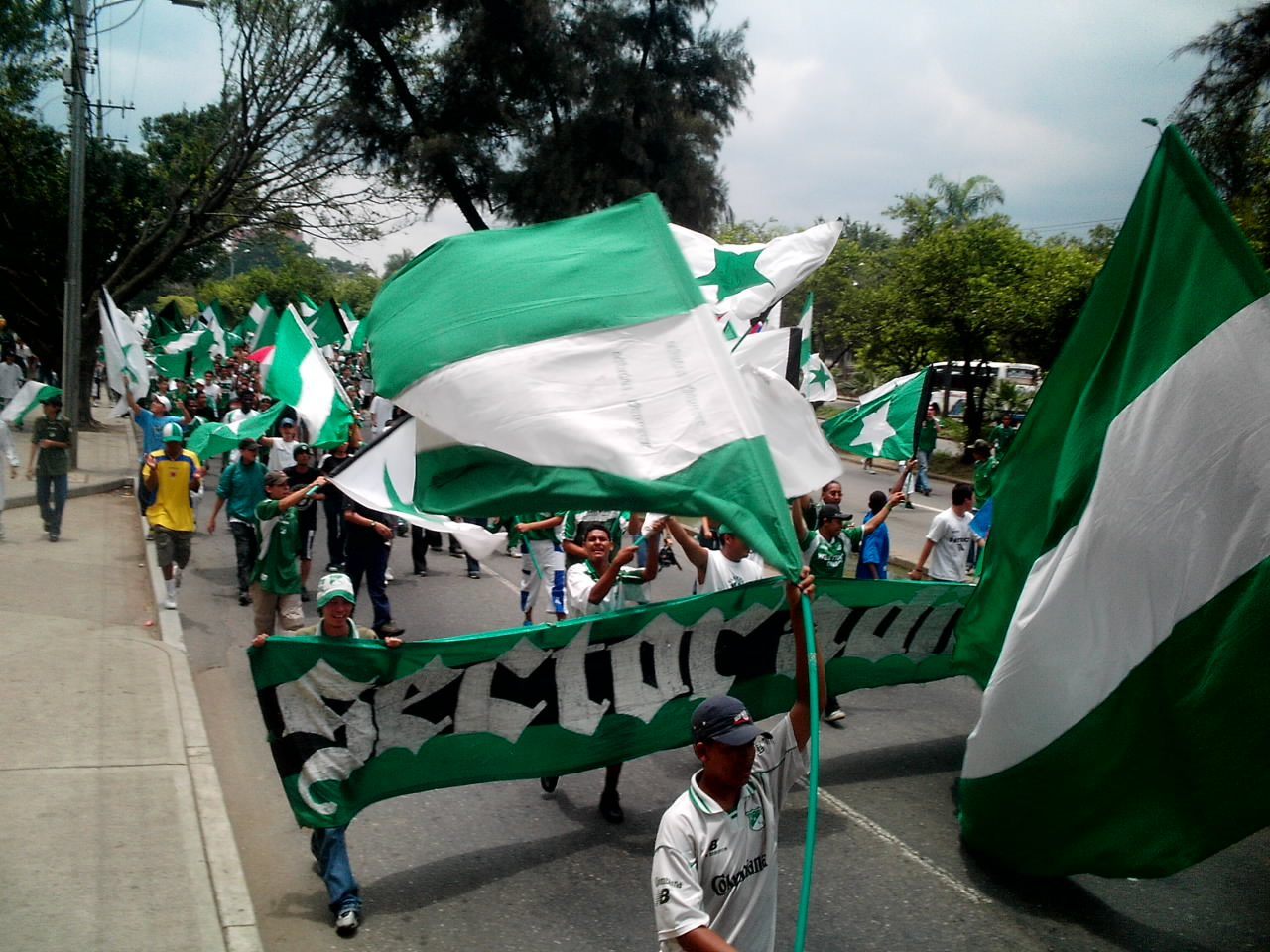 Frente radical Verdiblanco of Deportivo marching towards stadium to attend the Cali derby
