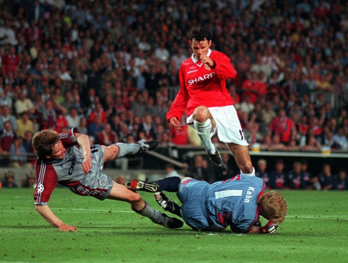 In a game of hard fought battle, Bayern took the lead as Mario Basler scores the first goal from a sublime free kick. They hit the wood-work twice but couldn't extend their lead. In picture, Ryan Giggs jumps over Bayern Munich goalkeeper Oliver Khan and Michael Tarnat during the match