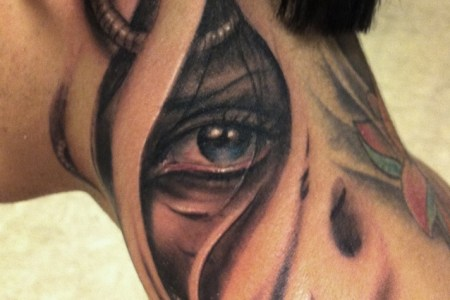 biomechanical eye tattoo on neck for men.