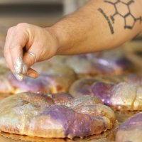 The glittery king cake from Sucre. (Photo via Sucre New Orleans on Facebook)