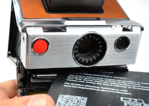 Carefully insert a dark slide OVER the top of images inside the cartridge