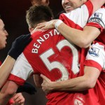 Squillaci header gives Arsenal win at a cost