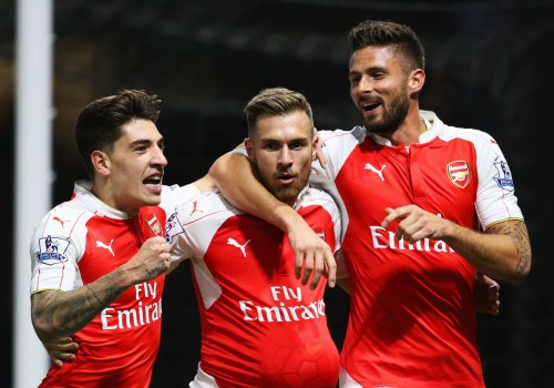 WATFORD, ENGLAND - OCTOBER 17:  Aaron Ramsey of Arsenal (C) celebrates with Hector Bellerin (L) and Olivier Giroud (R) as he scores their third goal during the Barclays Premier League match between Watford and Arsenal at Vicarage Road on October 17, 2015 in Watford, England.  (Photo by Jan Kruger/Getty Images)