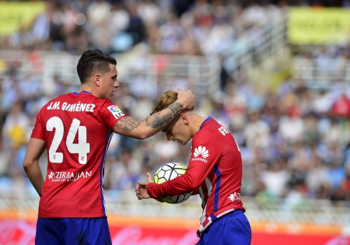 Atletico Madrid's Jose Maria Gimenez and Antoine Griezmann celebrate a goal during their Spanish first division soccer match against Real Sociedad at Anoeta stadium in San Sebastian