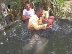 Pastor Mario Perez baptizing a young man in Esteli Nicaragua