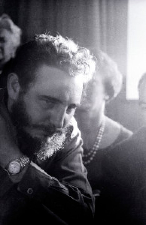 In his hotel suite, Fidel Castro talks to reporters about his sucessful Cuban revolution to ouster Dictator Batista