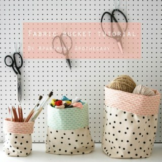 You can create these lovely baskets using the Fabric Bucket Tutorial by Apartment Apothecary. -Sewtorial