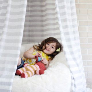 "Create a small reading nook or some ""me"" space for your little one with this Hula Hoop Tent tutorial by A Beautiful Mess. -Sewtorial"