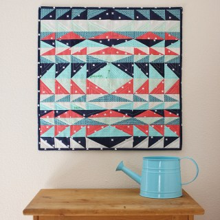 Looking to add a pop of color to your home's decor? Try this beautiful Mesa Mini Quilt by Michael Ann Made.