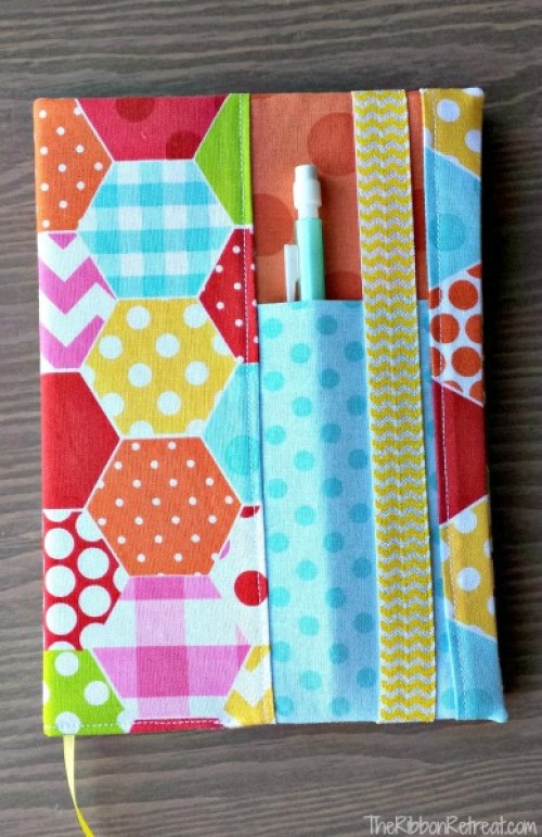 Just in time for back to school is this adorable fabric notebook cover tutorial by Ribbon Retreat. This is a great way to use up your scraps. -Sewtorial