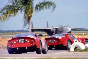The Alfa Romeo Giulia (#63) of Geki and Gaston Andrey heads the sister car of Lucien Bianchi and Bernard Constan during the 1966 12 Hours of Sebring.