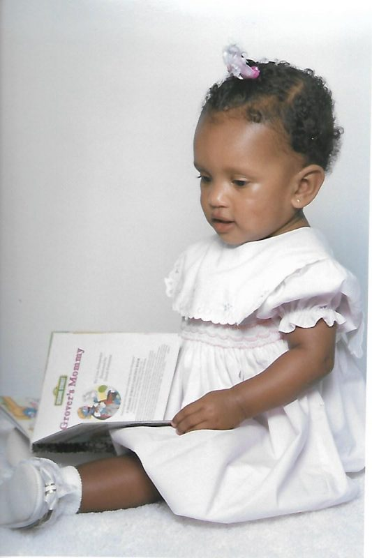 1 year old reading book CNF