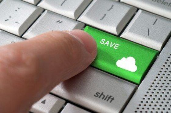 Business concept male finger pointing save to cloud key on  a metallic keyboard