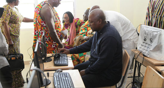 President Mahama trying out one of the computers in the ICT lab of the school