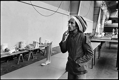 Bob Marley in Heidelberg, Germany, on the European Exodus Tour in 1977. Marley and the Wailers had just finished their sound check in the big auditorium when he wandered over to the far corner of the hall, where these prosthetic limbs were stored.