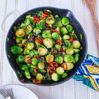 This plant-based main dish or side features Brussels Sprouts, Chili Peppers, and Black Beans. Found on The Grateful Grazer.