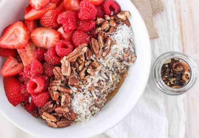 Vegan chai quinoa breakfast bowl with fresh berries from The Grateful Grazer.