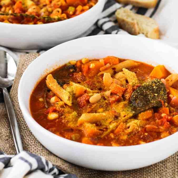Comforting Butternut Squash Vegan Minestrone Soup is healthy and easy to make. Recipe via www.gratefulgrazer.com