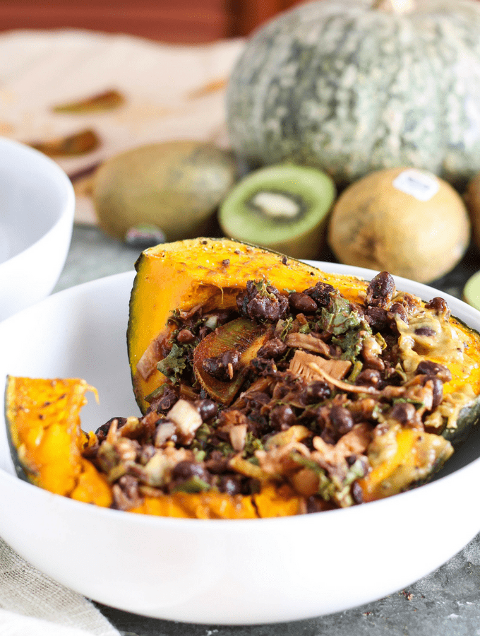 This vegan BBQ jackfruit recipe is perfect for fall/winter! Jackfruit & black beans are served in roasted kabocha squash bowls with creamy kiwi lime sauce.