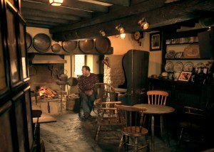 Fireplace and bar at The Fleece Inn