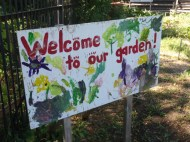 The first welcome sign to the EcoHouse Community Garden.