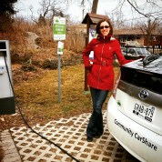 Kathryn Enders, Green Venture's current Executive Director, with one of our newest displays- an electric CarShare car!