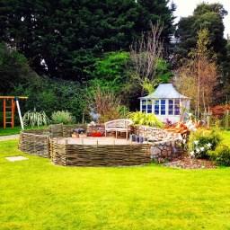 Willow fencing around patio area in centre of garden