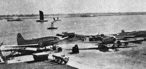 CNAC C-46 and DC-3 at the end of the Shanghai's Lunghwa airport runway, late 1940s
