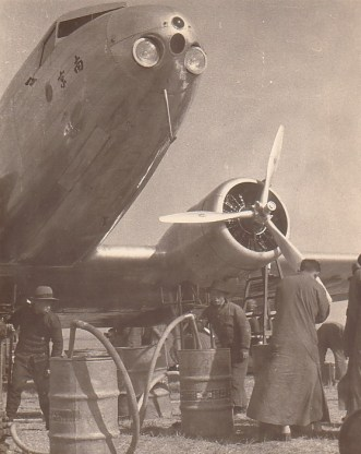 Hand fueling a DC-2, 1936