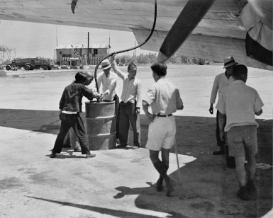 Hand fueling an airplane, location unknown