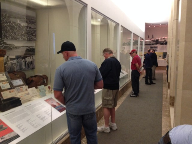 Members of the CNAC family check out the SFO Museum exhibit