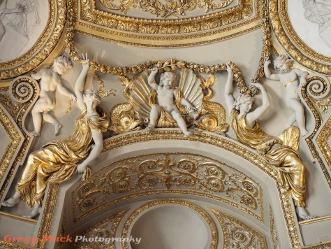 Artwork on the walls and ceiling at the Musée du Louvre