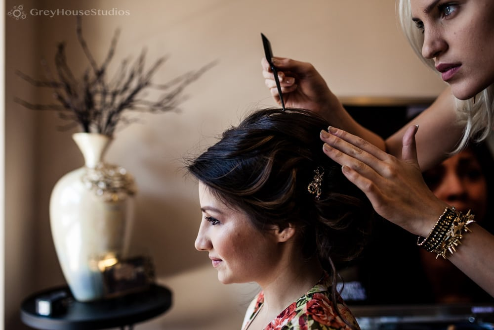 long island wedding photos bride getting hair styled