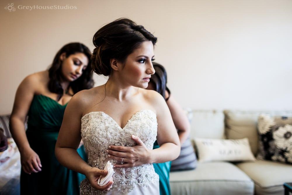 long island wedding photos bride putting on dress