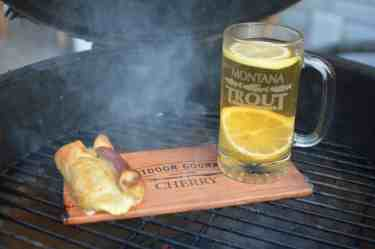 Puff Pastry Appetizer Cooking Next to a Hot Toddy on the Grill Plank