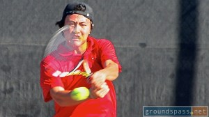 Johnny Wang swings through his backhand during the early rounds at the 2013 La HabraOpen Tennis Championships.