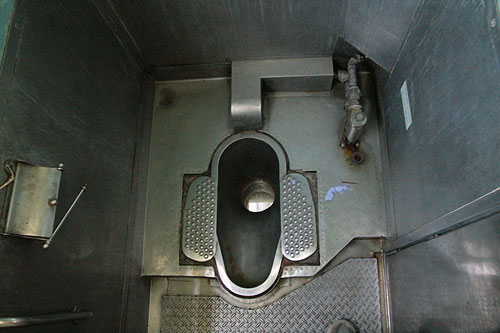 squat toilet on a train, india train squat toilet, asian toilets, toilets in india, toilets around the world
