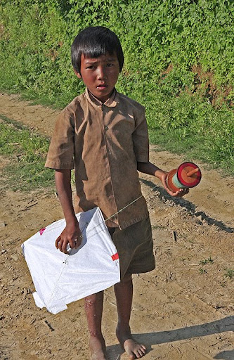 kite flying boy in Nepal
