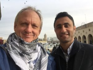Trying on Kurdish and Arab scarves in chilly Erbil, Iraq with my guide and friend Samir Barznjy