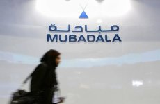 A Mubadala Development Co. employee walks past the company's